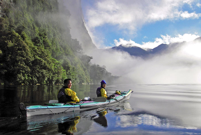 Kayaking during a cruise in Doubtful Sound, part of Fiordland National Park in New Zealand. Photo by Real Journeys